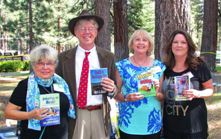 "I'm joined by three talented authors at the South Lake Tahoe Library's ""A Toast to Die For"" literary event. From left: Sue Owens Wright, Cindy Sample and Kathi Daley. Name badges features magnifying glasses--a great touch, but made my tie crooked."